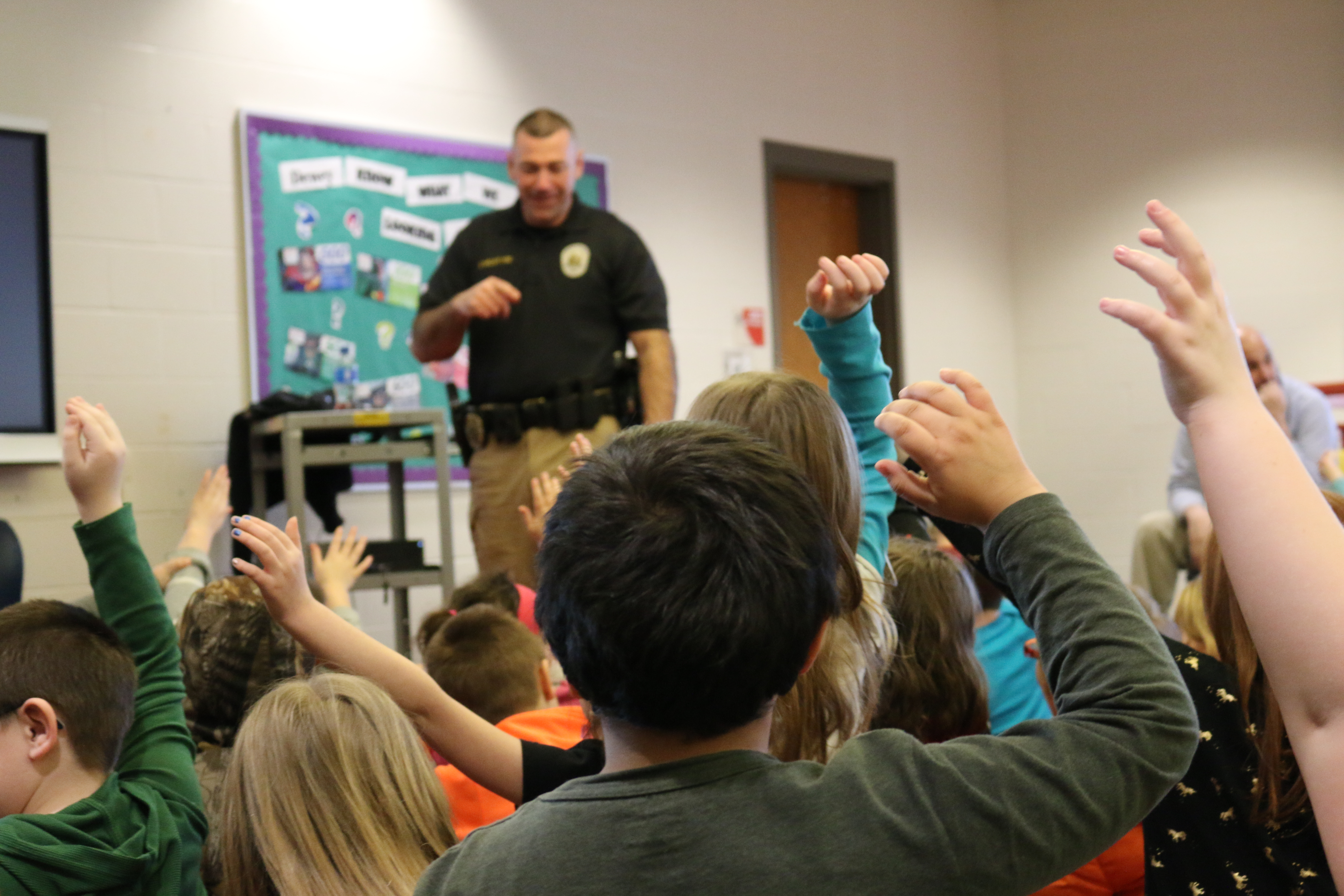 Ofc. McIntyre addresses 4th-grade students on internet safety as a part of the January edition of Career Connection Friday.